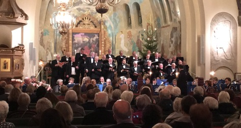 Julkonsert 2018 med Manskören Iris och Arvika stadsmusikkår i Trefaldighetskyrkan. Foto: David Fryxelius.